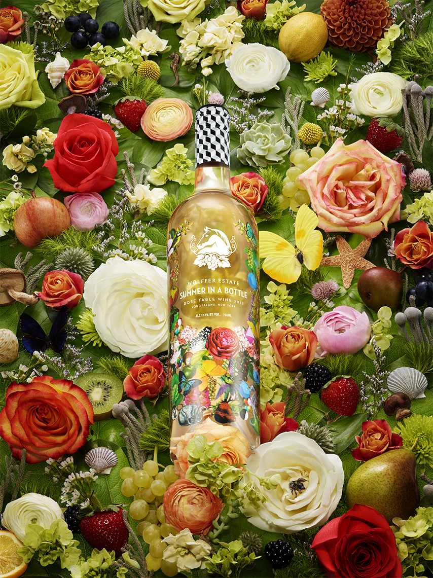 ROSE WINE BOTTLE SURROUNDED BY FLORAL SUMMER THEMED FLOWERS SHOT BY DAVID FILIBERTI