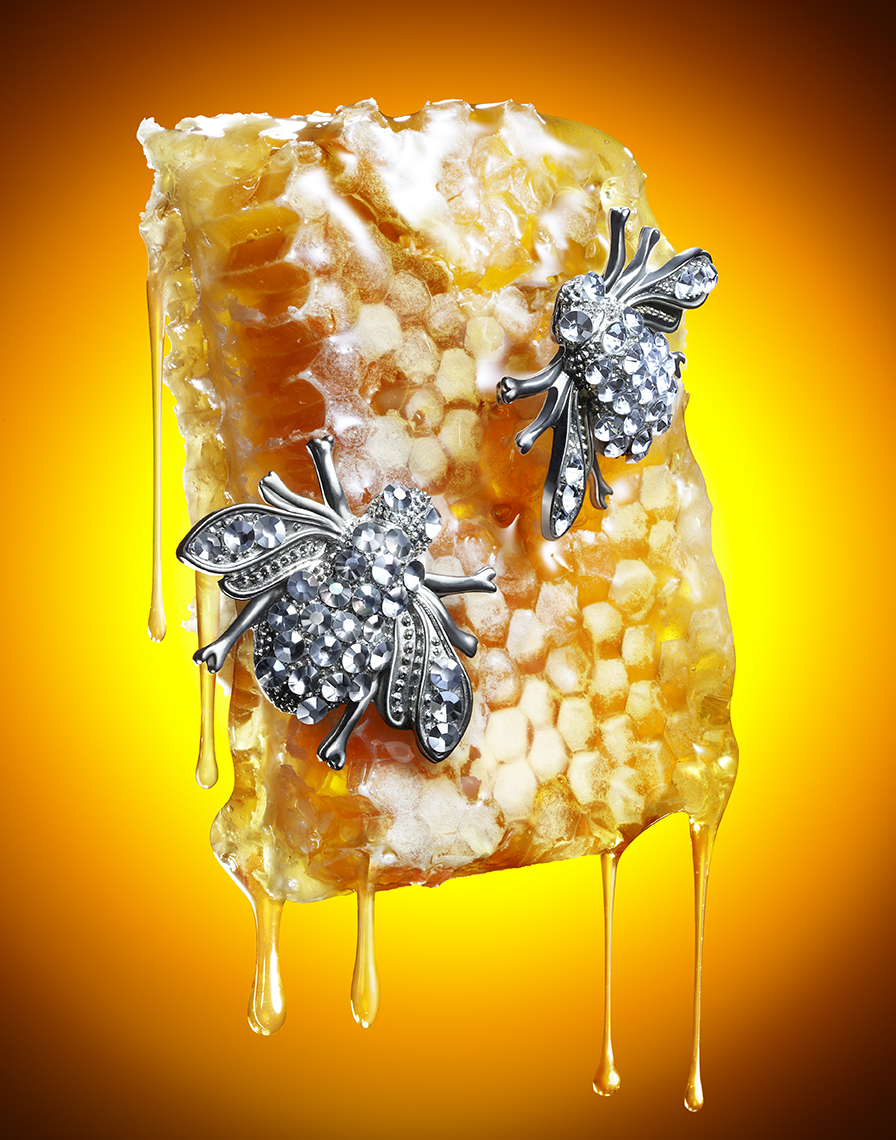 HONEY COMB WITH BEE SHAPED JEWELRY AND HONEY DRIPS SHOT BY DAVID FILIBERTI