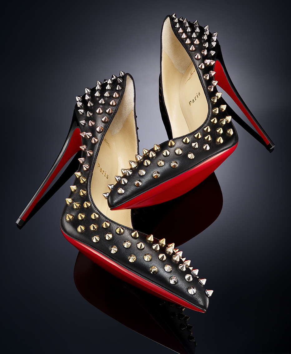 RED BOTTOM HIGH HEELED CHRISTIAN LOUBOUTIN SPIKES STUDS PUMPS SHOT BY DAVID FILIBERTI