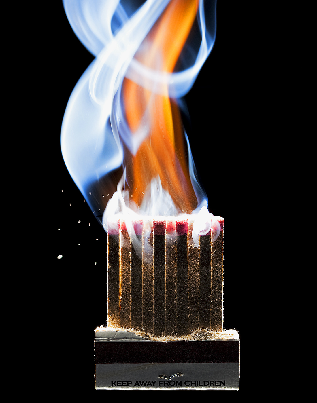 BOOK OF MATCHS SHOT AT THE EXACT MOMENT OF IGNITION SHOT BY DAVID FILIBERTI