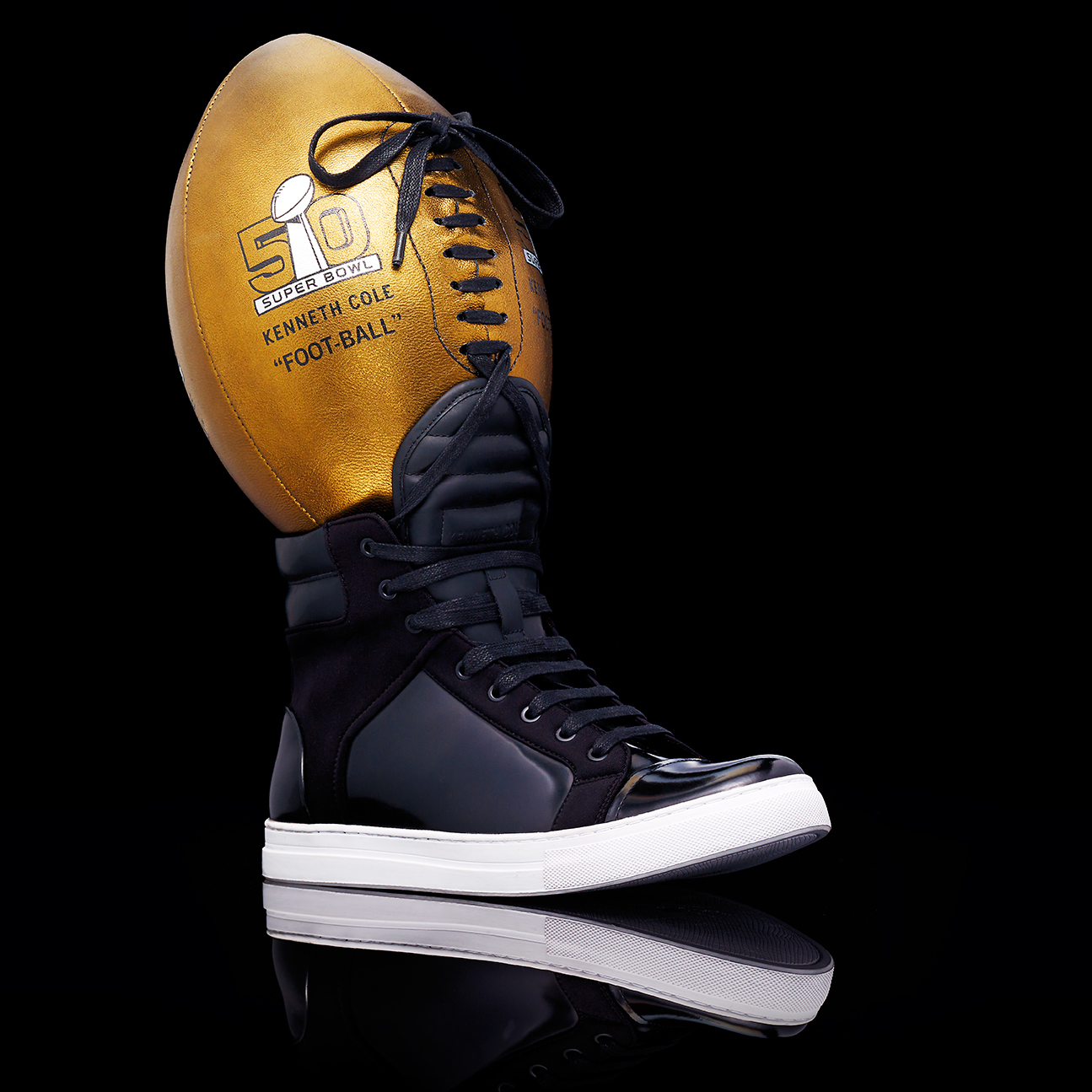 UNIQUE KENNITH COLE SHOE LACED TOGETHER WITH A SUPER BOWL 50 BALL SHOT BY DAVID FILIBERTI